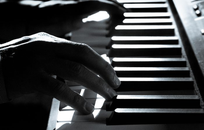 man playing piano keys