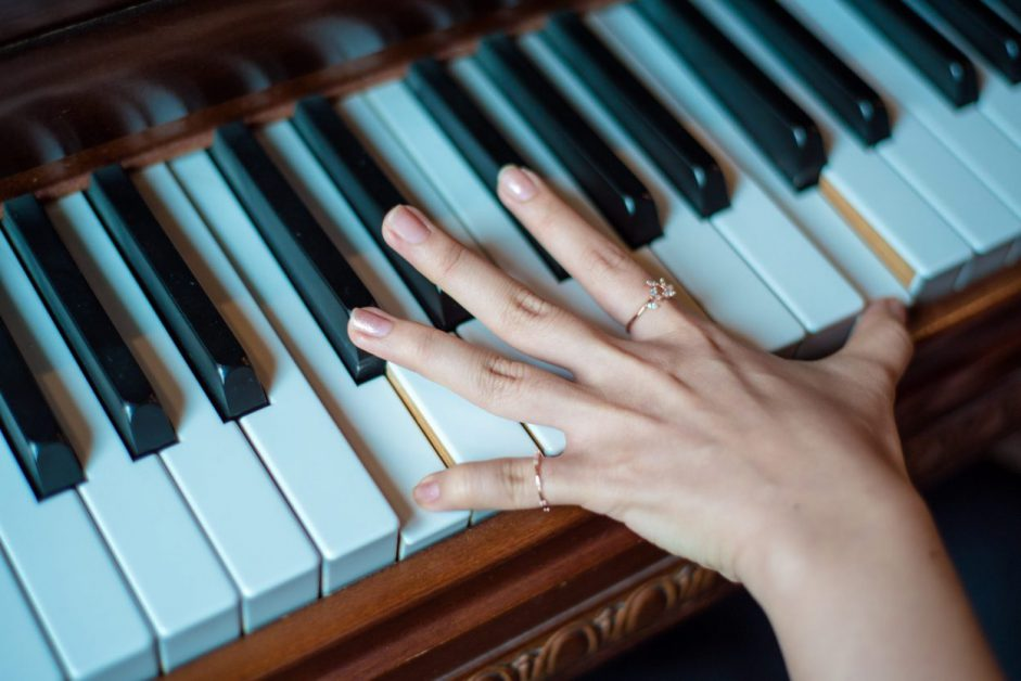 young female hand on piano keys