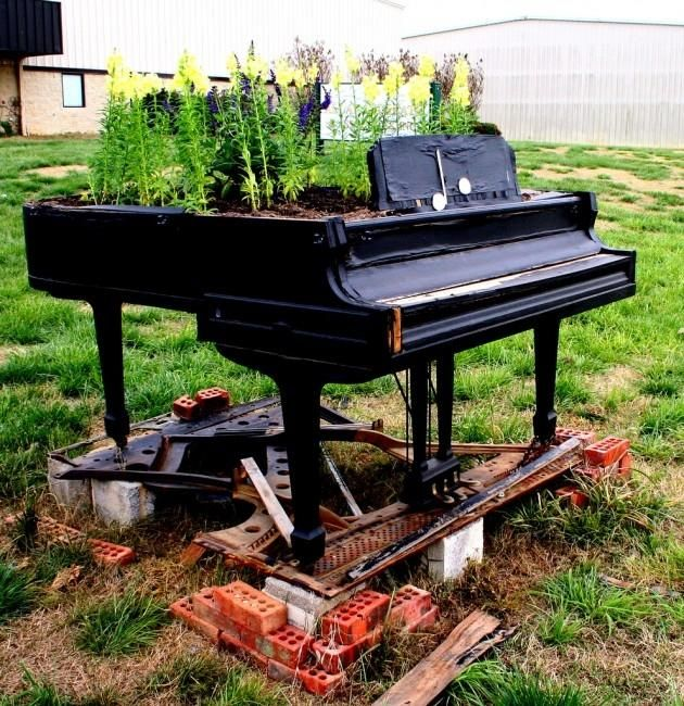Piano with garden growing from it