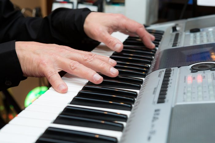 man playing keyboard