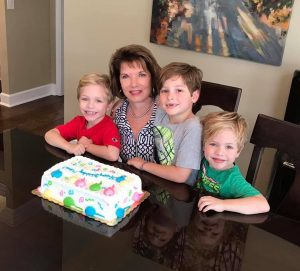 lady with grandkids and birthday cake