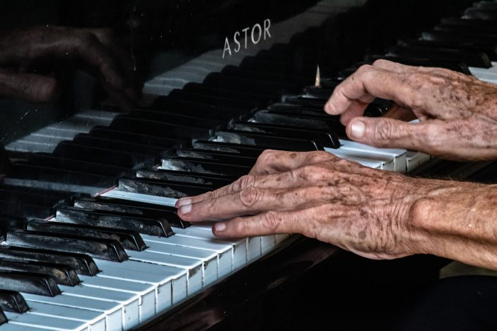 old person playing piano
