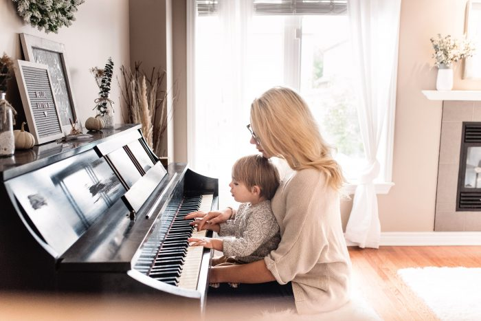 mom and baby at piano