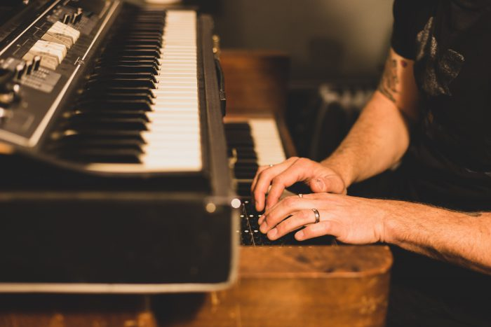 man sitting at piano playing